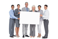 Business people holding blank board. In office Royalty Free Stock Photos