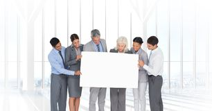 Business people holding blank card in office Stock Photo