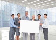 Business people holding blank card in office stock photography