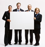 Business people holding blank paper. Business people holding a blank paper Royalty Free Stock Images