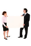 Business people holding blank poster board Royalty Free Stock Images