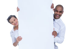 Business people holding blank sign Royalty Free Stock Photo