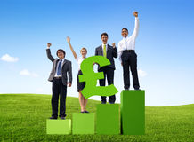Business People Holding British Pound on a Graph. Business People Holding British Pound on a Bar Graph Outdoors stock photography