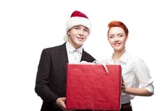 Business people holding christmas gift Stock Photos