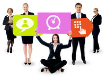 Business people holding colorful boards Stock Photo