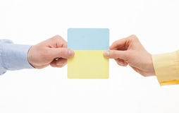 Business people holding colorful paper cards Stock Photos