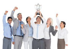 Business people holding cup and cheering Royalty Free Stock Image