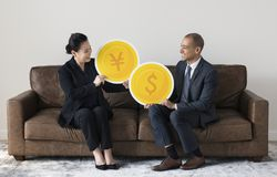 Business people holding currency icons Royalty Free Stock Photos