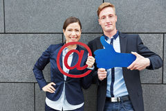 Business people holding email sign Stock Photos