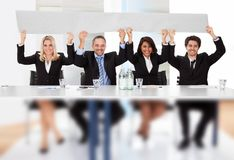 Business people holding empty placard Royalty Free Stock Photography