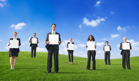 Business People Holding Empty Placard Outdoors Royalty Free Stock Photos