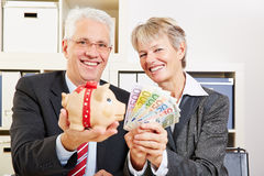 Business people holding Euro money Royalty Free Stock Images