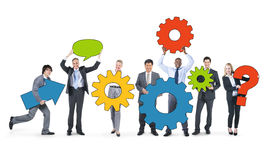 Business People Holding Gears Together Royalty Free Stock Photography