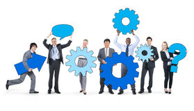 Business People Holding Gears Together Concept Stock Images