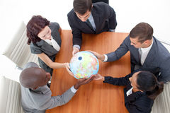 Business people holding a globe Stock Photo