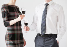 Business people holding goblets of wine Stock Image