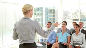 Business people holding grade during meeting stock footage