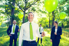 Business People Holding Green Balloons Stock Image