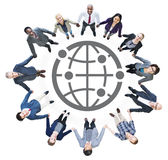 Business People Holding Hands and Globe Symbol Stock Photo