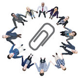 Business People Holding Hands and Paper Clip Symbol Royalty Free Stock Image