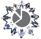 Business People Holding Hands and Pie Chart Royalty Free Stock Image