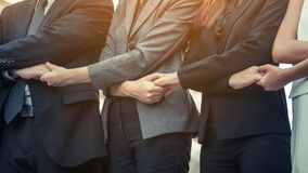 Business people holding hands showing teamwork. royalty free stock photo