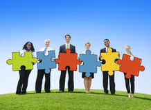 Business People Holding Jigsaw Pieces Outdoors Stock Images