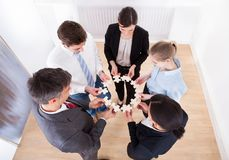 Business people holding jigsaw puzzle Stock Photo