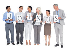 Business people holding letters sign Royalty Free Stock Photo