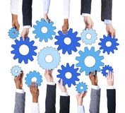 Business People Holding Machine Parts Royalty Free Stock Photography