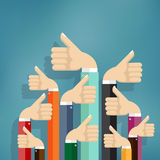 Business people holding many thumbs up. Royalty Free Stock Photo