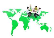 Business People Holding a Meeting On a Green World Royalty Free Stock Images