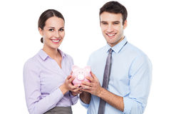 Business people holding piggy bank Royalty Free Stock Photo