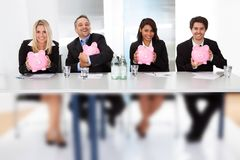 Business people holding piggy banks Royalty Free Stock Photography