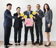 Business people holding piggybank icon Royalty Free Stock Photos