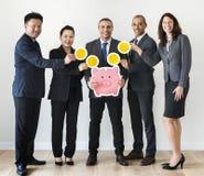 Business people holding piggybank icon Stock Photos