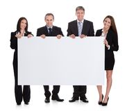 Business people holding placard Royalty Free Stock Image