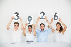 Business people holding score cards Royalty Free Stock Photo