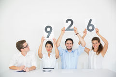 Business people holding score signs Royalty Free Stock Photo