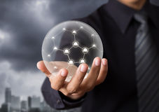 Business people holding social network in crystal ball. Technology concept Stock Photos