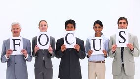 Business people holding supports with the word FOCUS Stock Images