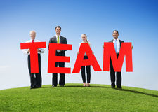 Business People Holding TEAM Royalty Free Stock Image
