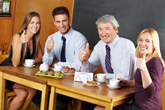 Business people holding thumbs up Royalty Free Stock Photos