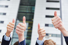 Business people holding thumbs up Stock Photo