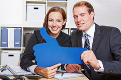 Business people holding thumbs up Stock Image