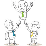 Business people holding up colleague Stock Photos