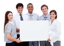 Business people holding a white card Royalty Free Stock Images