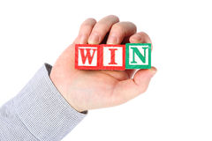 Business people holding win word. On white background stock images