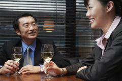 Business People Holding Wineglasses At Cafe Table Stock Images