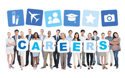 Business People Holding Word Careers and Related Symbols Stock Image